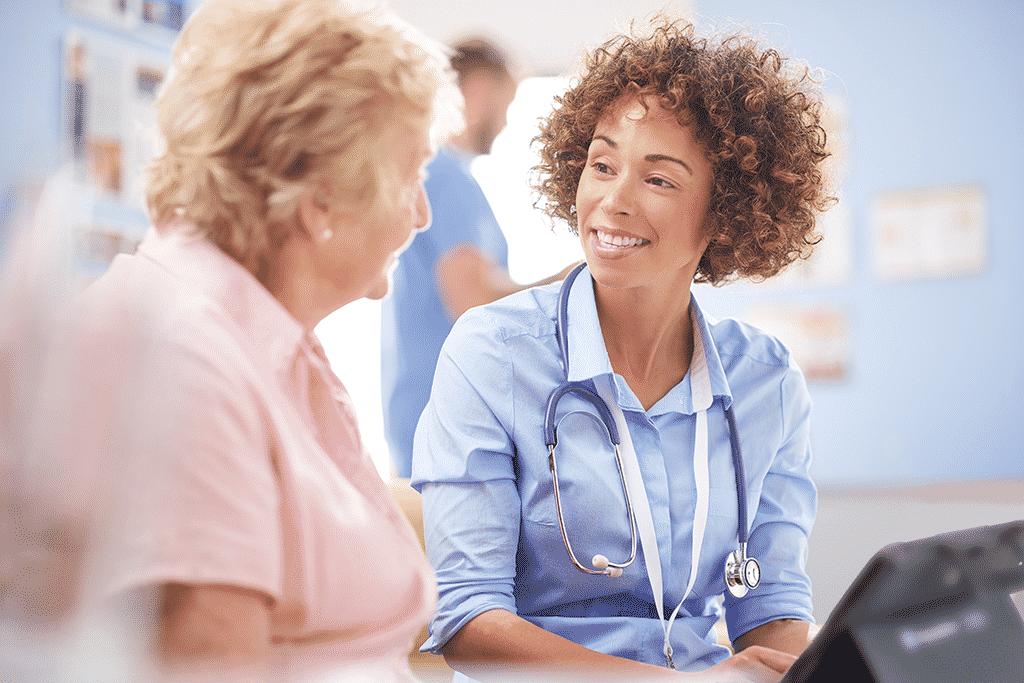 Speech-language pathologist with her patient
