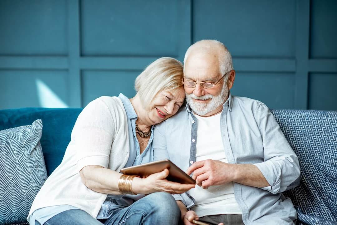 Senior couple with tablet at home